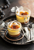 Date and coconut creme brulee with black sesame seeds in a glass