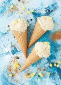 Three Cones of Pineapple Ice Cream with Pineapple Chunks
