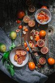 Peeled blood oranges in bowl