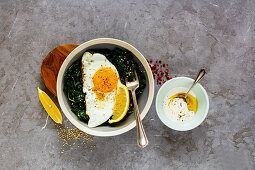 Fresh vegetarian lunch bowl with fried egg, kale and sesame seed