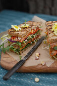 A healthy seeded sandwich with vegetables