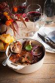 Braised pork marrow bones with onions