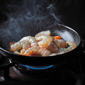 Prawns cooking in pan