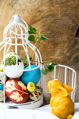 Coloured Easter eggs in a white cage
