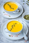 Pumpkin cream soup with pumpkin seeds