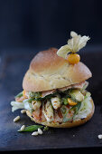 A brioche sandwich with white asparagus and physalis