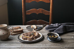 Lentil and shiitake cream with bread and olives on a rustic wooden table