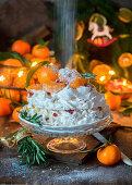 Pavlova with tangerines and sugar powder