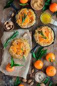 Mini almond tangerine pies before baking