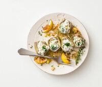 Artichokes stuffed with ricotta and vegetables on sauteed leeks