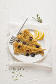 Gratin cod with capers and olives