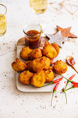 Vegan pumpkin fritters with chilli, miso and caramel dipping sauce