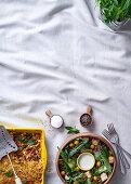 Vegetable lasagne and crispy tofu salad
