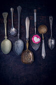 Vintage spoons and a chocolate praline