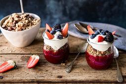 Granola layered with fruit puree and yogurt