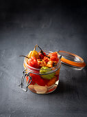Pickled chilli peppers in a flip-top jar