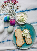 Sliced bread plait with cream cheese and cress on an Easter table