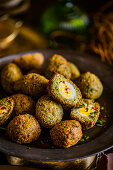 Quail's eggs wrapped in falafel for an Easter high tea