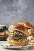 Homemade burger with portobello mushroom, avocado and sprouts