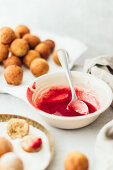 Farm cheese donut balls with strawberry sauce