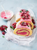 Swiss roll with yoghurt and raspberry filling, sliced