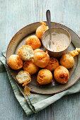 Sicilian Arancini: baked rice donuts with a yoghurt dip