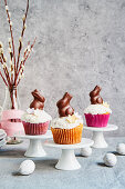 Carrot muffins with white chocolate, grated coconut and chocolate bunnies