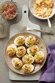 Hard-boiled eggs stuffed with ham, egg yolks and sprouts