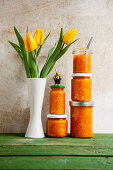 Carrot and orange marmalade with ginger, daffodils and an Easter bunny as decoration