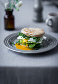 A English muffins with a poached egg, avocado, spinach and cress for an Easter breakfast