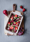 Fruit salad with berries, pears, pomegranate seeds and mint for Easter