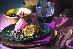 Lentil soup with cranberries, mulled wine pears and goat's cheese in a gingerbread crust