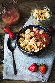 Semolina pudding with strawberry and rhubarb compote and crumbles