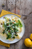 Papardelle with savoy cabbage, lemons and caramelised nuts