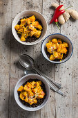 Bowls of lentils with pumpkin, chilli and sesame seeds