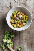 Pumpkin gnocchi with Brussels sprouts, dried tomatoes and Parmesan