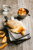 Semolina slices with apricot compote and icing sugar
