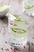 A Gin & Tonic with cucumber and pink peppercorns