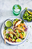 Baja fish tacos with red cabbage, jalapenos and avocado dressing