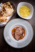 Ostrich steak served with rice and flatbread (India)