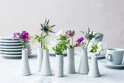 Edible flowers in vases as table decorations