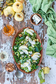 Green herb and vegetable salad with apple, grapes, walnuts and blue cheese