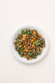 Spelt fusilli with pumpkin, black cabbage and almond pesto and roasted pumpkin seeds
