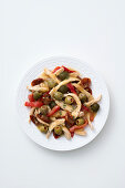 Chicken breast strips with peppers, stuffed olives and sun-dried tomatoes