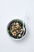 Black rice salad with chicken breast, peas and cashew nuts