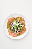 Tomato carpaccio with ricotta and pesto