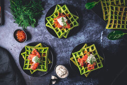 Spinach waffles with smoked salmon and horseradish cream