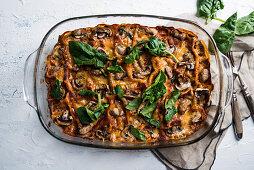 Vegan spinach and mushroom lasagna in a casserole dish