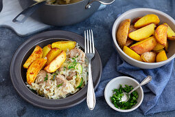 Pork loin with cabbage and baked potatoes
