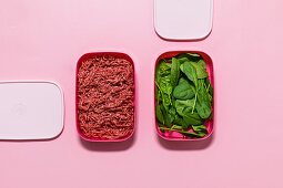 Minced meat and spinach leaves being stored
